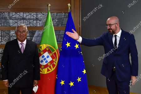 European Council President Charles Michel (R) gestures as he greets Portugal's Prime Minister Antonio Costa ahead of a bi-lateral meeting on the first day of a European Union (EU) summit at The European Council Building in Brussels, Belgium, 01 October 2020.