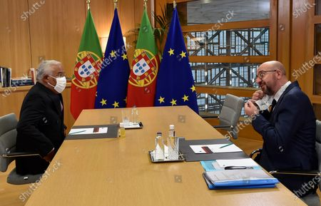 European Council President Charles Michel speaks with Portugal's Prime Minister Antonio Costa during a meeting on the sidelines of an EU summit at the European Council building in Brussels