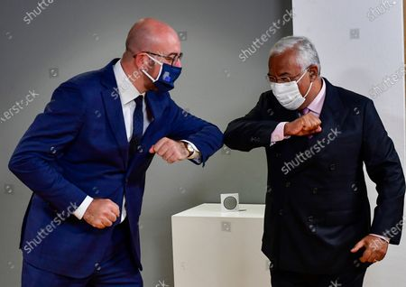 European Council President Charles Michel, left, greets Portugal's Prime Minister Antonio Costa with an elbow bump ahead of a meeting on the sidelines of an EU summit at the European Council building in Brussels