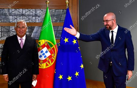 Stock Photo of European Council President Charles Michel, right, greets Portugal's Prime Minister Antonio Costa ahead of a meeting on the sidelines of an EU summit at the European Council building in Brussels