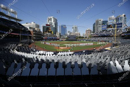 Stock Image of Jon Foreman is show singing the national anthem before the San Diego Padres played the St. Louis Cardinals at Petco Park on Wednesday, Sept. 30, 2020. (K.C. Alfred / The San Diego Union-Tribune)