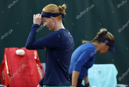 Alison Van Uytvanck of Belgium (L) passes by  Irina Bara of Romania during a break during their women's second round match during the French Open tennis tournament at Roland Garros in Paris, France, 01 October 2020.