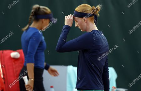 Alison Van Uytvanck of Belgium (R) passes by  Irina Bara of Romania during a break during their women's second round match during the French Open tennis tournament at Roland Garros in Paris, France, 01 October 2020.