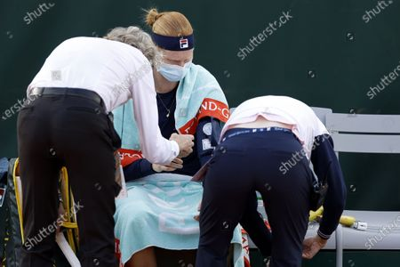 Alison Van Uytvanck of Belgium receives treatment during her women's second round match against Irina Bara of Romania at the French Open tennis tournament at Roland Garros in Paris, France, 01 October 2020.