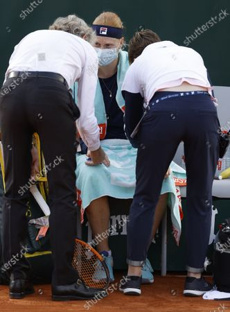 Stock Picture of Alison Van Uytvanck of Belgium receives treatment during her women's second round match against Irina Bara of Romania at the French Open tennis tournament at Roland Garros in Paris, France, 01 October 2020.