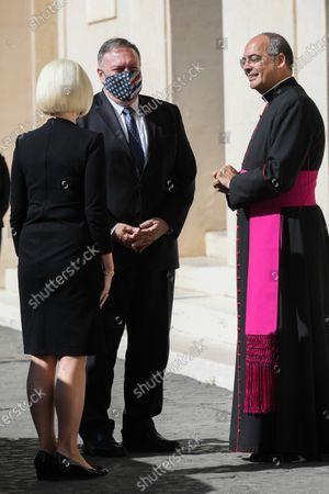 U.S. Ambassador to the Holy See Callista Gingrich, U.S. Secretary of State Mike Pompeo (C), Monsignor Guillermo Karcher at the San Damaso courtyard to meet Vatican Secretary of State Cardinal Pietro Parolin, at the Vatican