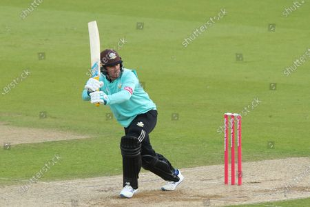 Stock Image of Jason Roy of Surrey hits the ball for four runs