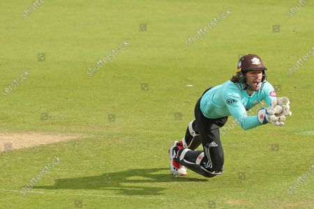 Wicketkeeper Ben Foakes of Surrey catches the ball to dismiss Daniel Bell-Drummond of Kent