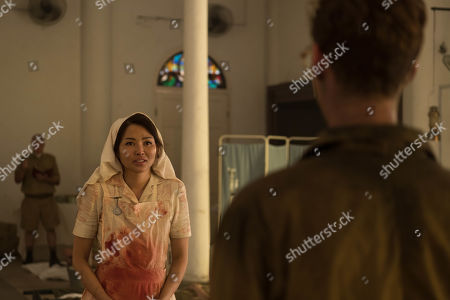 Stock Picture of Elizabeth Tan as Vera Chang.
