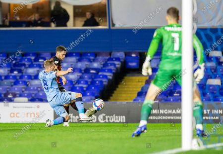 Jack Simpson of AFC Bournemouth crosses the ball past Jamie Allen of Coventry City toward the goal; St Andrews Stadium, Coventry, West Midlands, England; English Football League Championship Football, Coventry City v AFC Bournemouth.