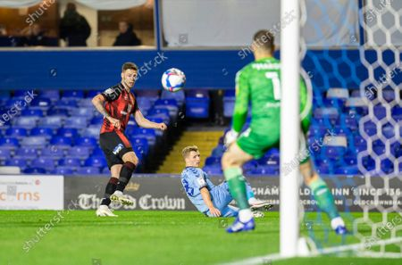 Jack Simpson of AFC Bournemouth crosses the ball past Jamie Allen of Coventry City toward the goal and Coventry City Goalkeeper Marko Marosi; St Andrews Stadium, Coventry, West Midlands, England; English Football League Championship Football, Coventry City v AFC Bournemouth.