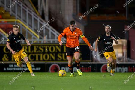 Calum Butcher of Dundee United strides away from Scott Tiffoney and Scott Robinson of Livingston; Tannadice Park, Dundee, Scotland; Scottish Premiership Football, Dundee United versus Livingston.