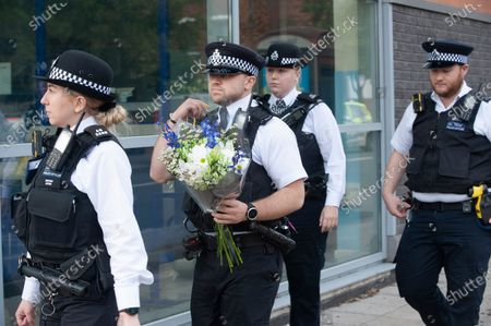 Police officers arrive with flowers. Metropolitan Police Commissioner Cressida Dick was at Croydon Custody Centre this morning for a visit. The murder investigation continues at pace after the death of police sergeant Matt Ratana almost a week ago at the Croydon Custody Centre in South London.