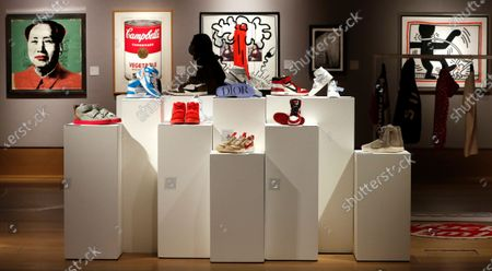 Selection of sneakers to be sold as part of the Pop Culture auction at Bonhams auction house in London, . Including, a pair of Nike Sky Jordan 1, 1985 with Chicago Bulls White, Black and Red colour way estimated at 14,000-16,000 UK pounds, center right, a pair of Dior X Nike Air Jordan 1 High OG sneakers 10,000-12,000 UK pounds (US dollars 13-15,000), top centre, and a pair of Nike Air Yeezy 2 Red October 2014, 12,000-14,000 UK pounds ( US dollars 15-18,000), center left, when sold in the auction on Oct. 8