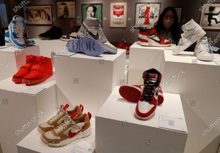Selection of sneakers to be sold as part of the Pop Culture auction at Bonhams auction house in London, . Including, a pair of Nike Sky Jordan 1, 1985 with Chicago Bulls White, Black and Red colour way estimated at 14,000-16,000 UK pounds, bottom right, a pair of Dior X Nike Air Jordan 1 High OG sneakers 10,000-12,000 UK pounds (US dollars 13-15,000), top centre, and a pair of Nike Air Yeezy 2 Red October 2014, 12,000-14,000 UK pounds ( US dollars 15-18,000), when sold in the auction on Oct. 8