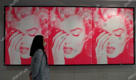 Work by artist Russell Young entitled 'Marilyn Crying (Triptych)' 2011, on view for the Pop Culture art sale at Bonhams auction house in London, . The work is valued at 50,000-70,000 UK pounds (64,000-90,000 US dollars) when sold at the auction on Oct. 8