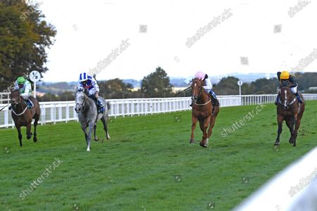 Stock Photo of Winner of The Weatherbys TBA Conditions Stakes Apollo One  (pink) ridden by Martin Harley and trained by Peter Charalambous during Horse Racing at Salisbury Racecourse on 1st October 2020