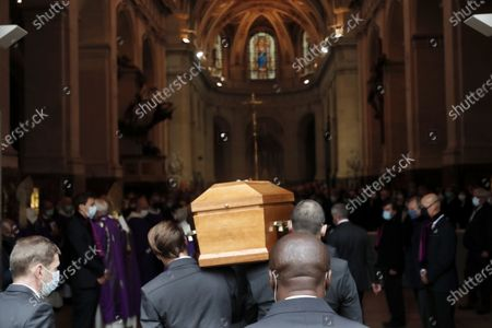 Men carry the coffin of late French actor Michael Lonsdale during a funeral ceremony at Saint Roch church in Paris, France, 01 October 2020. Lonsdale died at the age of 89 on 21 September 2020.