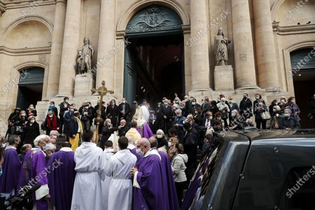 Stock Picture of Men carry the coffin of late French actor Michael Lonsdale out of Saint Roch church following a funeral ceremony, in Paris, France, 01 October 2020. Lonsdale died at the age of 89 on 21 September 2020.