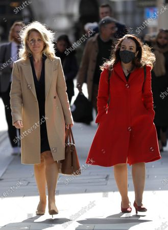 Jennifer Robinson lawyer for Julian Assange, left, and his fiancee Stella Moris, right, return to the Old Bailey in London, as the Julian Assange extradition hearing to the US continues