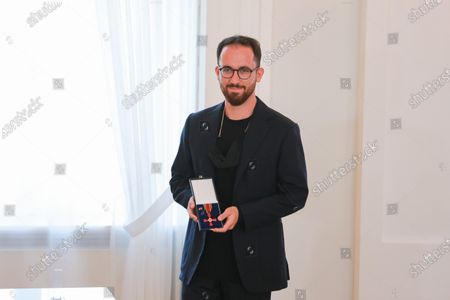 Igor Levit, Professor of Piano, poses with the medal, after receiving the Order of Merit of the Federal Republic of Germany from German President Frank-Walter Steinmeier, during a ceremony at the Schloss Bellevue in Berlin, Germany, 01 October 2020.