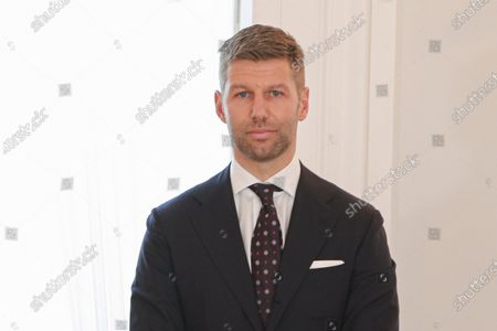 Stock Image of Thomas Hitzlsperger, the former professional soccer player, receives the Order of Merit of the Federal Republic of Germany from German President Frank-Walter Steinmeier, during a ceremony at the Schloss Bellevue in Berlin, Germany, 01 October 2020.