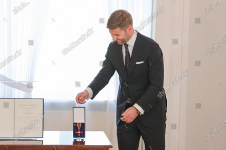Thomas Hitzlsperger, the former professional soccer player, poses with the medal, after receiving the Order of Merit of the Federal Republic of Germany from German President Frank-Walter Steinmeier, during a ceremony at the Schloss Bellevue in Berlin, Germany, 01 October 2020.