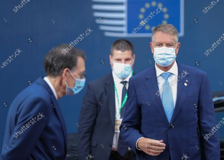 Romania's President Klaus Werner Iohannis (R)  arrives for an EU summit at the European Council building in Brussels, Belgium, 01 October 2020. European Union leaders are meeting to address a series of foreign affairs issues ranging from Belarus to Turkey and tensions in the eastern Mediterranean.