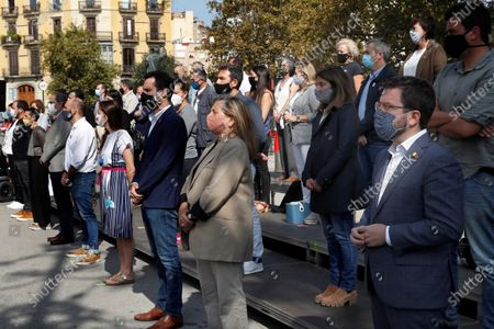 Former Catalonia's President Quim Torra (3rd-L) and his interim substitute Pere Aragones (R) attend an event in which entities and pro-independence parties commemorate the third anniversary of the unilateral referendum of 01 October in Barcelona, north-eastern Spain, 01 October 2020.