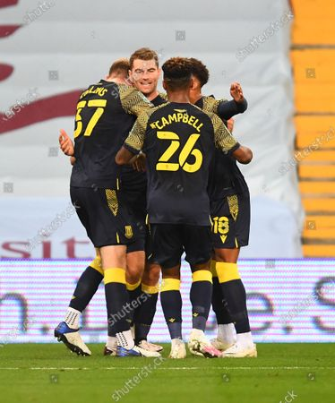 Sam Vokes of Stoke City celebrates with teammates after scoring his side's first goal