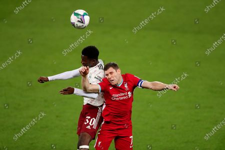 Eddie Nketiah of Arsenal and James Milner of Liverpool