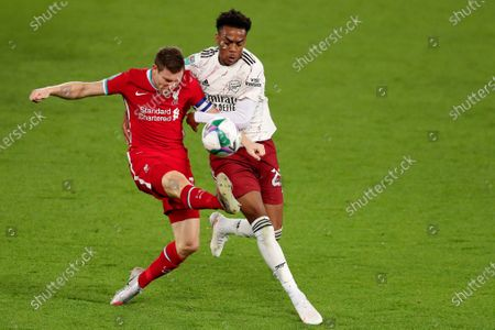Stock Picture of James Milner of Liverpool and Joe Wilock of Arsenal
