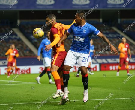 Stock Photo of Alfredo Morelos of Rangers challenges for the ball with Younes Belhanda of Galatasaray