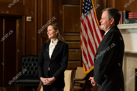 United States Supreme Court nominee Judge Amy Coney Barrett, listens as US Senator Steve Daines (Republican of Montana) speaks during their meeting on Capitol Hill,, in Washington. Credit:Manuel Balce Ceneta / Pool via CNP