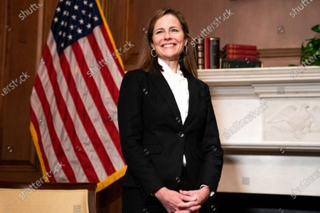 Judge Amy Coney Barrett, United States President Donald J. Trump's nominee for Supreme Court, poses for a photo before a meeting with US Senator Steve Daines (Republican of Montana), at the US Capitol Building in Washington DC.