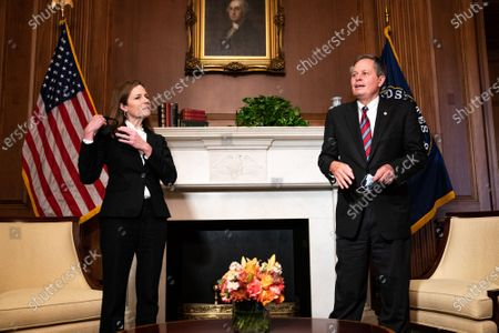Judge Amy Coney Barrett, United States President Donald J. Trump's nominee for US Supreme Court, and United States Senator Steve Daines (Republican of Montana), pose for a photo before a meeting at the United States Capitol Building in Washington DC.