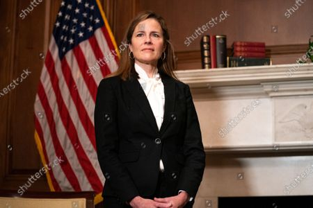 United States Supreme Court nominee Judge Amy Coney Barrett, listens as US Senator Steve Daines (Republican of Montana) speaks during their meeting on Capitol Hill,, in Washington.