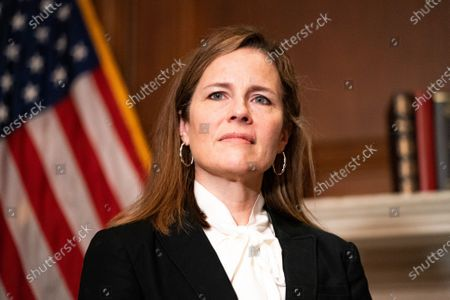 Stock Picture of United States Supreme Court nominee Judge Amy Coney Barrett, listens as US Senator Steve Daines (Republican of Montana) speaks during their meeting on Capitol Hill,, in Washington.