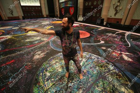 "British artist Sacha Jafri describes on his painting titled ""The Journey of Humanity"" in Dubai, United Arab Emirates, . The painting with size of two football fields is part of his project ""Humanity Inspired"" and he hopes to raise 30 million USD to support health and education initiatives for children living in poverty worldwide"