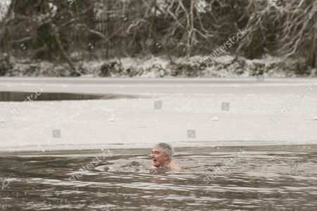 Lord David Freud braves the icy water
