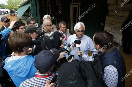Bob Baffert, trainer of Kentucky Derby winner Justify, speaks with reporters at Pimlico Race Course in Baltimore ahead of the Preakness Stakes horse race. Baffert is undefeated taking the Kentucky Derby winner to the Preakness, but for the first time in 20 years he'll do so without assistant trainer Jimmy Barnes, who broke his right wrist in a paddock accident at Churchill Downs