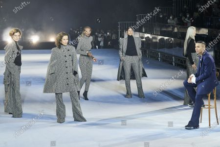Olivier Rousteing and models on the catwalk