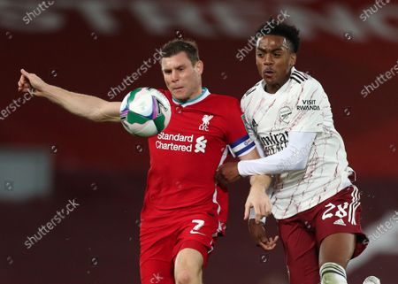 James Milner of Liverpool competes for the ball with Joe Willock of Arsenal; Anfield, Liverpool, Merseyside, England; English Football League Cup, Carabao Cup, Liverpool versus Arsenal.