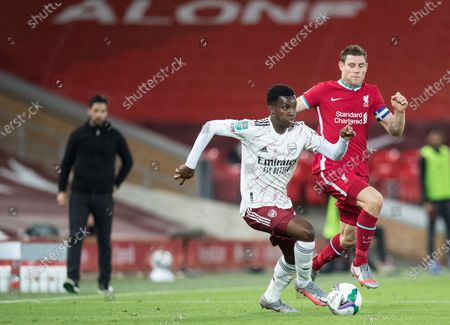 Eddie Nketiah of Arsenal shields the ball from James Milner of Liverpool; Anfield, Liverpool, Merseyside, England; English Football League Cup, Carabao Cup, Liverpool versus Arsenal.