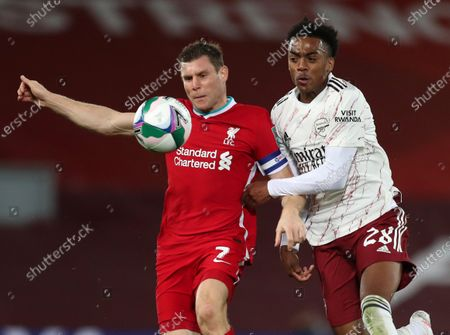 James Milner of Liverpool wins the ball from Joe Willock of Arsenal; Anfield, Liverpool, Merseyside, England; English Football League Cup, Carabao Cup, Liverpool versus Arsenal.