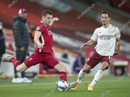James Milner of Liverpool passes the ball as Cedric Soares of Arsenal challenges; Anfield, Liverpool, Merseyside, England; English Football League Cup, Carabao Cup, Liverpool versus Arsenal.