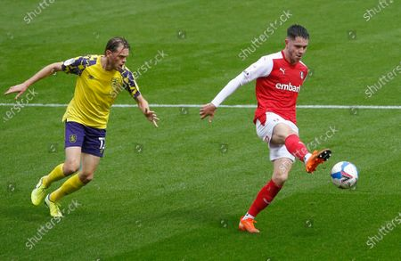 Stock Photo of Rotherham's George Hirst holds off Huddersfield Town's Richard Stearman