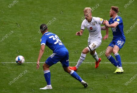 Lasse Sorenson of Milton Keynes Dons  and Ed Bishop of Ipswich Town  in action