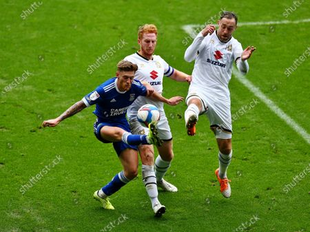 Stock Image of Ed Bishop of Ipswich Town  controls the ball under pressure from Richard Keogh and Dean Lewington of Milton Keynes Dons