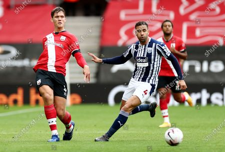 Jannik Vestergaard of Southampton and Hal Robson-Kanu of West Bromwich Albion.